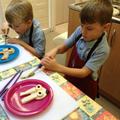 Child slices food.