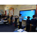 Year 2 children work together to measure the class