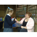 Child receiving her prize from the Easter Hunt.