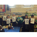 Children show the amount of money raised.