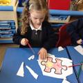 Child colouring and cutting.