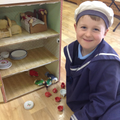 Child plays with a dolls house.