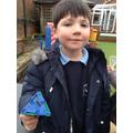 A child finds a woodlouse.