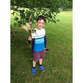Child finds items for his journey stick.