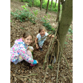 Class 1 children building a den for a small animal