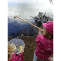 Class 1 child collects water from the lake.