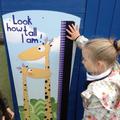 Child investigating height.