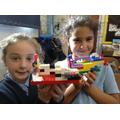 Children build buildings using Lego.