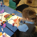 A child creating their art inspired by Eric Carle