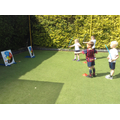 Children in games club try archery.