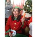 The happy elf looks after the reindeer's carrots.