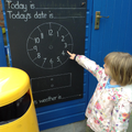 Child finds numbers on a clock.
