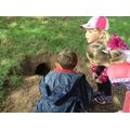 Children find an animal burrow.