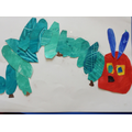 A child's finished caterpillar picture.