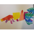 A finished chameleon, in the stye of Eric Carle.