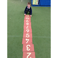 Child orders numbers to create a number line.