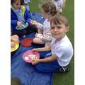 Children eat their open sandwiches.