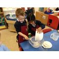 Children making pancakes.