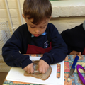 Child uses a cutter tool to make a circle shape.