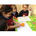 Children make toppings for a pancake.