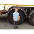 Child is the same height as the lorry wheel.