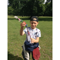 Year 2 child with their journey sticks