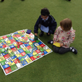 Child finds numbers on a board game.
