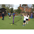 Children practise their tennis skills in club.