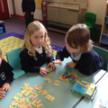 Children playing a number game.