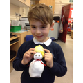 A child with his finished snowman.
