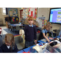Children investigate materials to make a parachute