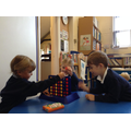 Children in breakfast club playing board games.
