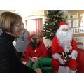 Mrs Cusack, Head Elf and Santa.