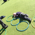 Child measures using hoops.