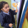 Child also sees numbers on a height chart.