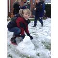 A child makes a snowman