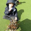 Child counting sticks.