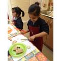 Child uses cutting skills.