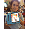 Child uses an ipad to draw a burning Tudor house.