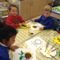 Children painting sunflower pictures