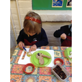 Child cutting pear.