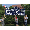 Children hold the school banner.