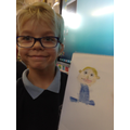Child with their finished self portrait.