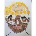 A childs finished collage self portrait.