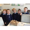 Children that are going to grow the potatoes.