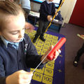 A child uses a ruler to measure with.