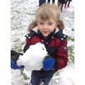 Child enjoying playing in the snow