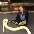 Mrs Whitefoot reading about reptiles.