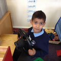 Child in role play area.