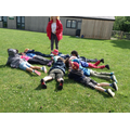 Class 1 use bodies to make a large spider.